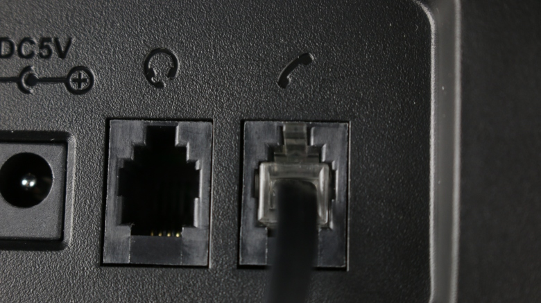 picture of a telephone headset and handset ports
