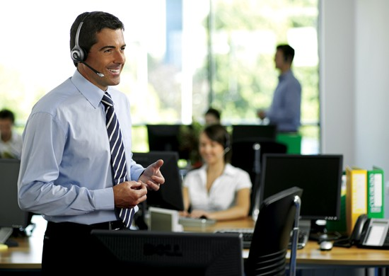 businessman in office on wireless headset