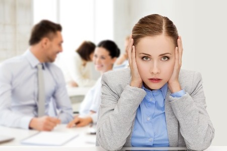 woman in office bothered by people noise