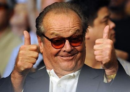 Jack Nicholson smiling with two thumbs up