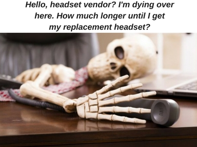 skeleton laying over a desk with hand on telephone receiver