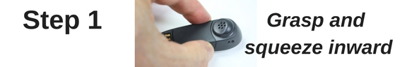 thumb and index finger squeezing on plantronics CS50 battery door cover
